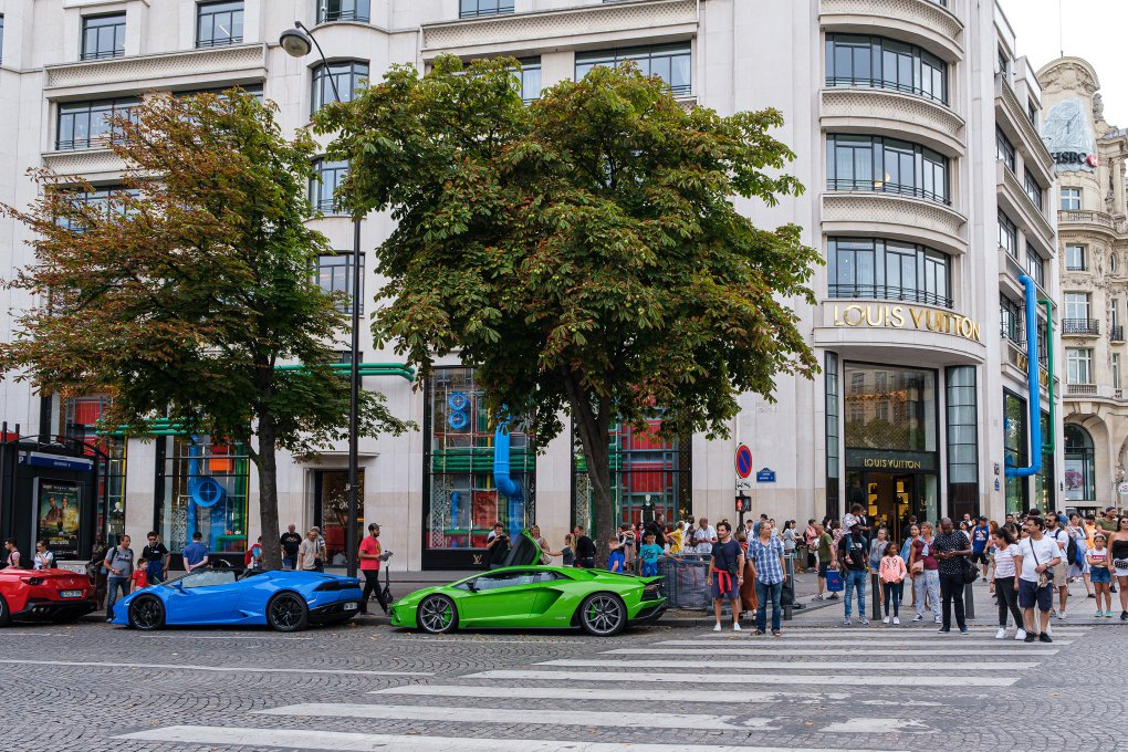 Supercars in front of the Louis Vuitton store