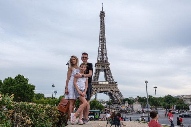 Our family in front of the Eiffel Tower